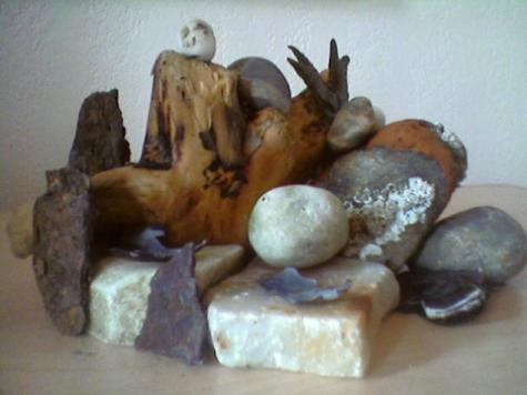 Seattle rocks, seaweed, driftwood, shells, rusty Underground iron, and a chunk of barnacled & eroded brick with mortar.